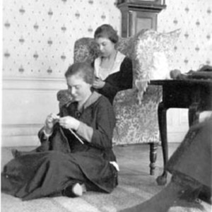 Interior Views, Smith students knitting in the parlor