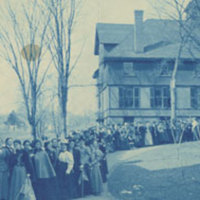 Smith College students waiting in line to see a basketball game in Alumnae Gymnasium on Rally Day, 1900.