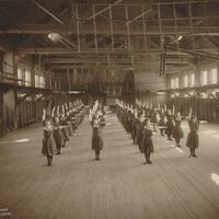 "Smith College students doing ""floor work"" in Alumnae Gymnasium, 1904."