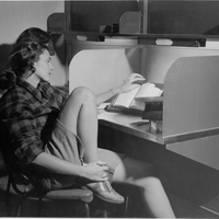 Student studying in carrel at Neilson Library, undated.