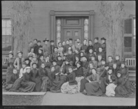 Group photograph of the class of 1892 with John Stoddard, professor of physics and chemistry, in front of Dewey House, 1891.