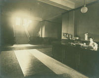 Smith College Library loan desk and interior main staircase, c1910.