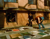Damaged books outside of Neilson Library after Seeleye Reference Room fire on October 21, 1975.