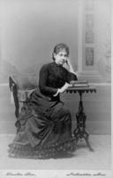 Photograph of Sarah Kellogg seated, c1881.